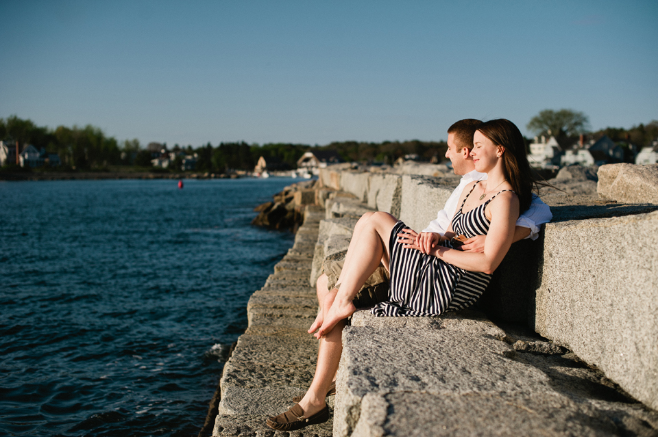 couple lounging on breakwater